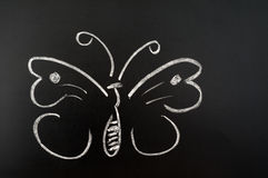 Butterfly. Drawn with chalk on a blackboard stock photos