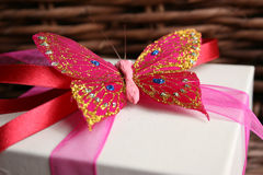 Butterfly. Close up of a butterfly as a decoration on a gift box Royalty Free Stock Image
