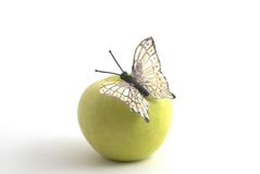 Butterfly on the apple. Butterfly on the green apple Royalty Free Stock Photography