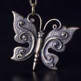 Butterfly as trinket or pendant Royalty Free Stock Photos