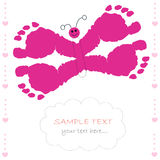 Butterfly with baby prints baby girl greeting card Royalty Free Stock Photos