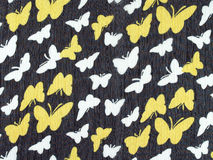 white and yellow butterfly pattern on black fabric background Royalty Free Stock Photography