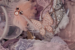 Butterfly and beads on lace background Stock Photos
