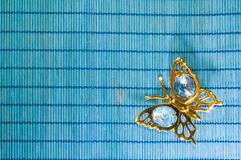 Butterfly On Blue Bamboo Background Royalty Free Stock Image