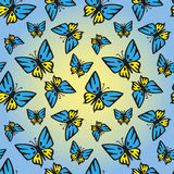 Butterfly blue-yellow seamless texture. Butterfly with yellow-blue wings on a yellow-blue background. Color butterflies symbolize the national flag of Ukraine Royalty Free Stock Photo