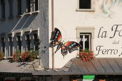 Butterfly on a building. Decorative ironwork sculpture. stock image