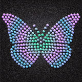 Butterfly. Built of translucent gems on a background of black and gray fabric stock illustration