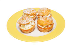 Butterfly buns on plate Royalty Free Stock Photos