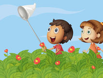 Butterfly catchers in the garden Royalty Free Stock Photos
