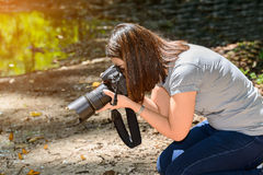 Butterfly caught on camera. women photographers take photos Butt Stock Photo