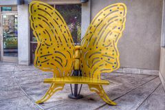 Butterfly Chair. Yellow Butterfly Chair in a shopping area in Austin Stock Images