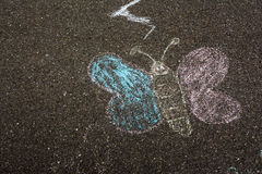 Butterfly Chalk Drawing on Asphalt Ground Children Playing Playground royalty free stock image