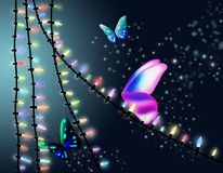 Butterfly and Christmas lights. Royalty Free Stock Image