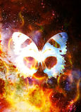 Butterfly in cosmic space and fire flame. Color cosmic abstract background. Stock Photo