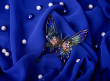 butterfly on dark blue fabric Royalty Free Stock Photos