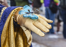Butterfly Decoration. Annecy,France-March 15,2014:Detail of a delicate butterfly decoration on the hand of a disguised person during the Annecy Venetian Carnival Stock Photo
