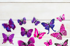 Butterfly decoration. On the white wooden background stock photo