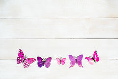 Butterfly decoration. On the white wooden background stock images