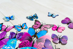 Butterfly decoration. On the white wooden background royalty free stock photos