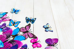 Butterfly decoration. On the white wooden background stock image