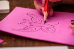 Butterfly Drawing. A girl drawing a picture of a butterfly stock photos