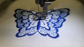 Butterfly embroidery by sewing machine Royalty Free Stock Photo