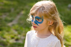 Butterfly face-painting. Girl with facepainting of blue butterfly royalty free stock photos