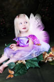 Butterfly Fairy. Little Fairy girl sitting amongst Monarch butterflies stock photography