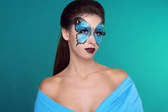 Butterfly fashion makeup on face beautiful woman. Royalty Free Stock Images