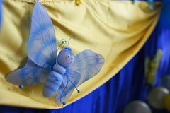 Butterfly figurine on a fabric Royalty Free Stock Image