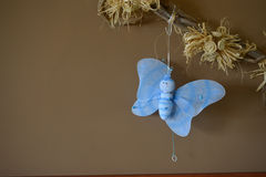Butterfly figurine on a fabric Stock Photo
