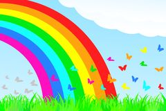 A butterfly flies through the rainbow. Stock Photos