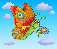 Butterfly with flower on blue sky Royalty Free Stock Photography