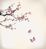 Butterfly and winter sweet. Butterfly flying on winter sweet Stock Images
