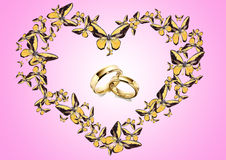 Butterfly in form heart and wedding ring Royalty Free Stock Photography