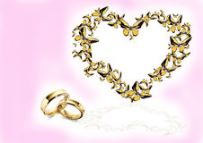 Butterfly in form heart and wedding ring Stock Photography