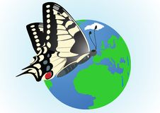 Butterfly on a globe Royalty Free Stock Photography