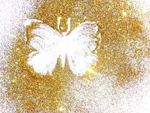 Butterfly of gold glitter on white background Stock Photos