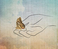 Butterfly on hand. Royalty Free Stock Photo
