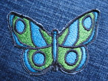 Butterfly on jeans. Butterfly  thread design on jeans texture Stock Image