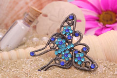 Butterfly Jewelry on Beach Stock Image