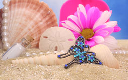 Butterfly Jewelry On Beach Royalty Free Stock Photo