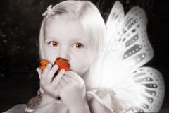 Butterfly Kiss. Fairy Girl with Butterfly Wings, Kissing butterfly royalty free stock photos