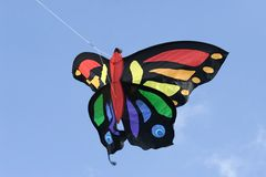 Butterfly kite. A colorful butterfly shaped kite flying in a blue sky Stock Photo