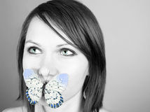 Butterfly on lips Royalty Free Stock Images