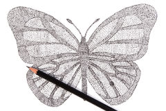 Butterfly made with pattern of dots. Royalty Free Stock Photo