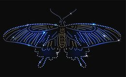 Butterfly made with precious gems on black background. For your design royalty free illustration