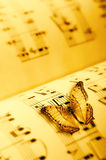 Butterfly on a music sheet Royalty Free Stock Photography