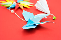 Butterfly origami. Blue butterfly origami on red background Royalty Free Stock Photo