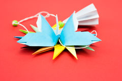 Butterfly origami. Blue butterfly origami on red background Stock Images